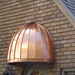 Rounded Copper Door Awnings